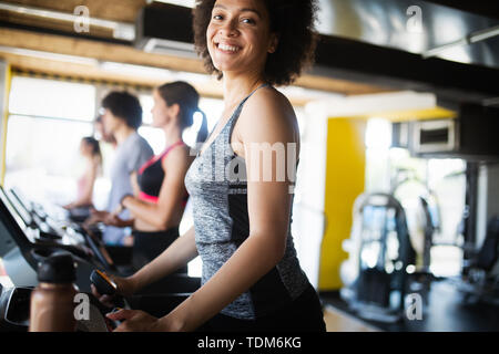 Picture of cheerful fitness team in gym - Stock Image