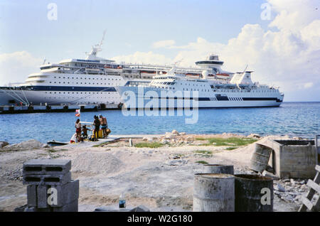 Cruise Ships docked in a port, possibly Cozumel Mexico ca. mid-1980s (Song of America and Crown Del Mar cruise ships) - Stock Image