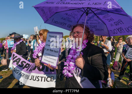 London, UK. 10th October 2018. Groups campaigning for women born in the 1950s to regain the pensions stolen from them under successive governments, including The Waspi Campaign (Women Against State Pension Inequality),  Back to 60, We Paid In, You Pay Out and others, hold a rally in Hyde Park before going to protest at Parliament. Credit: Peter Marshall/Alamy Live News - Stock Image