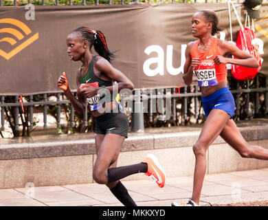 Vivian  Cheruiyot   and Brigid Kosgei,  both competing for Kenya in the 2018 Elite Women's London Marathon. They finished 1st and 2nd respectively. - Stock Image