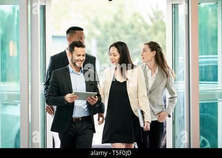 Business people entering in hotel lobby - Stock Image