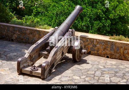 View of a cannon at the Iglesia de San Juan Bautista church in Deia. - Stock Image