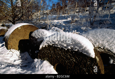 Millstones in the winter snow Peak District National Park Derbyshire - Stock Image