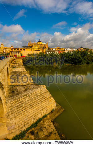 Roman Bridge (Puente Romano) and Rio Guadalquivir (river), Cordoba, Cordoba Province, Andalusia, Spain. - Stock Image