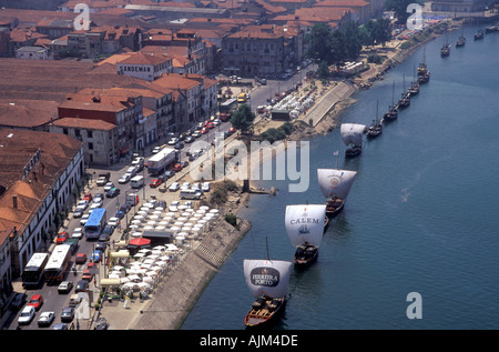 River Douro in Oporto Portugal with advertising port ships at the water - Stock Image