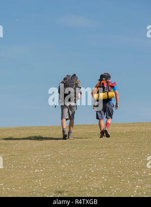 Two walkers hill walking on a sunny day in the English countryside. England UK - Stock Image