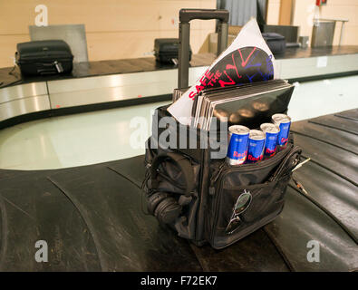 A DJ's bag of records on the luggage reclaim carousel at Ibiza airport - Stock Image