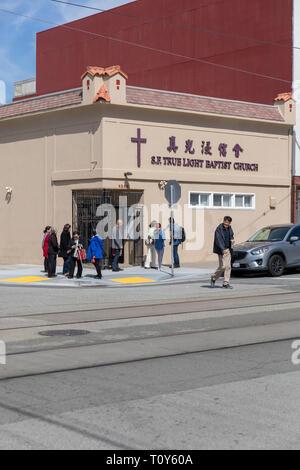 People outside San Francisco True Light Baptist Church, 48th Avenue, San Francisco, California, USA - Stock Image