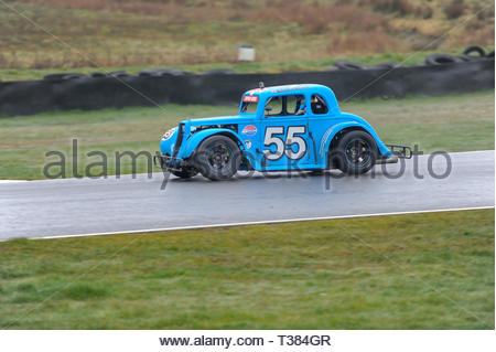 Dunfermline, Scotland, UK. 7th April, 2019. 55 Matt Rainbow into the Chicane during a Scottish Legends Championship race at Knockhill Circuit. During a wet and misty opening round of the Scottish Championship Car Racing season organised by the SMRC (Scottish Motor Racing Club) at Knockhill. Credit: Roger Gaisford/Alamy Live News - Stock Image