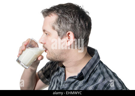 Picture of a man that is drinking a glass of milk - Stock Image