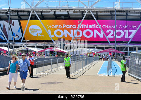 Stewards at spectator barriers to London 2017 World paralympics athletics championships games London stadium Queen Elizabeth Olympic Park Stratford UK - Stock Image