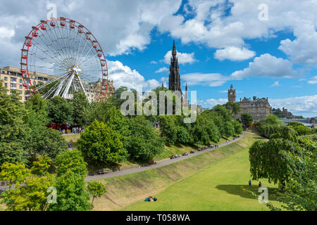 A Ferris Wheel, the Scott Monument and the Balmoral Hotel over Princes Street Gardens, Edinburgh, Scotland, UK - Stock Image