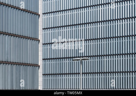 Modern office building with vertical shutters to screen the sun - Stock Image