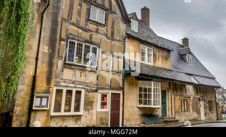 Chipping Campden's unique Cotswold sandstone classic  architecture is the home for shops restaurants and businesses in this old market town - Stock Image