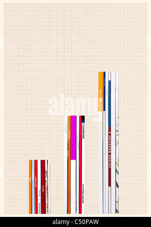 Magazines positioned to form a graph - Stock Image