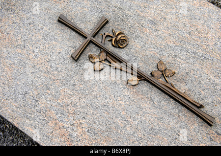 cross crucifix headstone grave cemetery graveyard religion germany deutschland sennelager faith stone death mortality - Stock Image