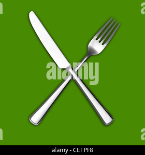 A still life shot of a knife and fork crossed on a green background (any colour background available on request) - Stock Image