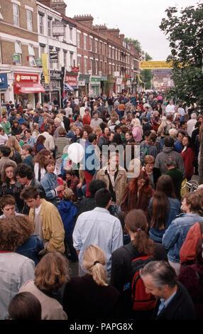 Crowd scene at a London street festival - Stock Image