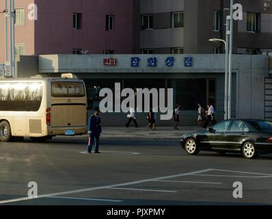 North Korean traffic officer directing traffic, Pyongyang, North Korea - Stock Image