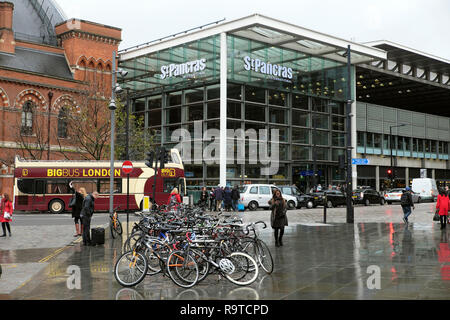View of street with parked bicycles outside St Pancras Station building along Pancras Road at Kings Cross & tourist Big Bus London N1 UK  KATHY DEWITT - Stock Image