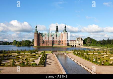The Frederiksborg Castle in Dutch Renaissance style and the baroque garden in Hillerød near Copenhagen, Denmark, - Stock Image