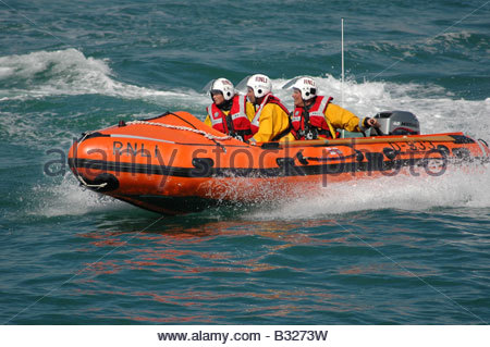 Members of the Lifeboat crew aboard the RLNI inshore lifeboat Selsey West Sussex August - Stock Image