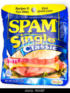 A Spam Single Classic slice packaged in a sealed pouch, a single serving of processed pork. - Stock Image