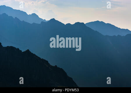 Mountains in the evening, dark mountainside with the evening light - Stock Image