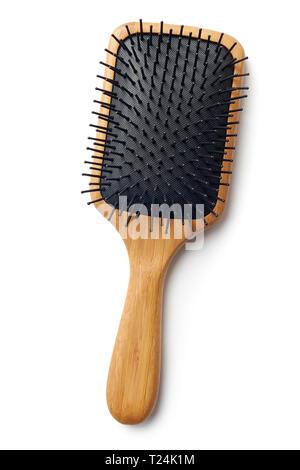 Bamboo Paddle Hair Brush On White Background - Stock Image