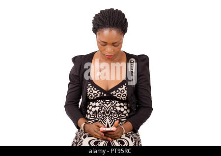 Beautiful young woman using a cell phone for texting - Stock Image