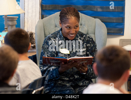 Sailors participate in Read Across America Day. - Stock Image