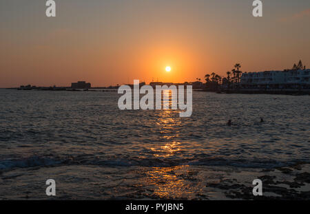 sunsetting over paphos town - Stock Image