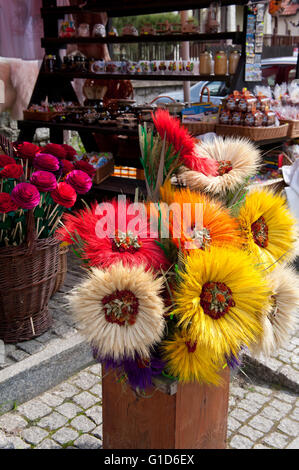 Artificial folk art sunflowers bunch made of cereal ears, souvenirs at the bazaar in bohemian Kazimierz Dolny, Poland, - Stock Image