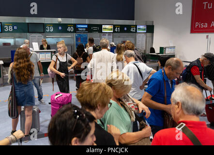 Passengers at the baggage check in, the terminal interior, Pisa International Airport, Pisa, Tuscany, Italy Europe - Stock Image