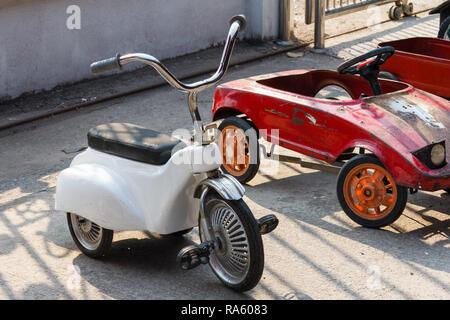 Pedal tricycle and pedal car dor sale at market, Damnoen Saduak, Thailand - Stock Image