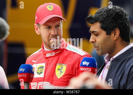 Silverstone Circuit. Northampton, UK. 13th July, 2019. FIA Formula 1 Grand Prix of Britain, Qualification Day; Scuderia Ferrari driver Sebastian Vettel is interviewed by Sky Television Credit: Action Plus Sports/Alamy Live News - Stock Image