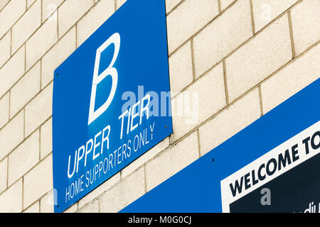 Spectator entrance signage 'Home Supporters Only' outside an entrance to the West Stand at Bolton Wanderers - Stock Image