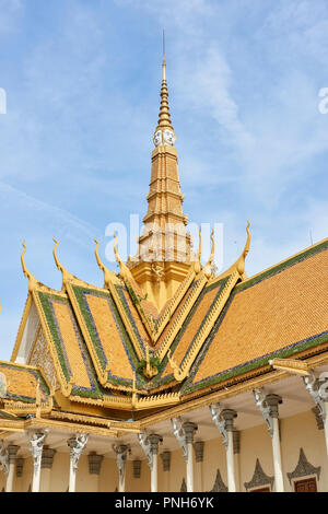Detail of Royal Palace's throne hall building gilt spire featuring stylised faces. In Phnom Penh, Cambodia. - Stock Image