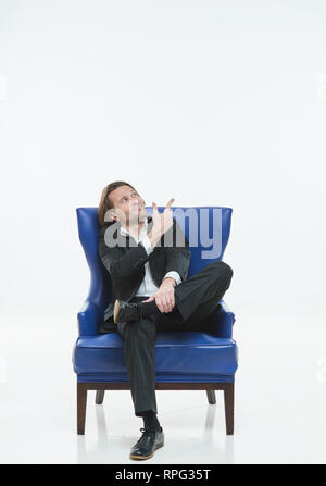 The handsome men in black suits differently pose on a white background, brutal man with long curly hairs, white shirts, business man, very stylish, blue leather chair - Stock Image