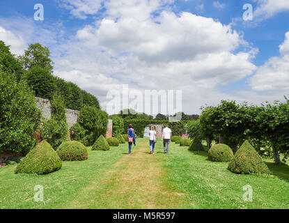Tourists walking in the grounds of the historic medieval grounds of Penshurst Place. - Stock Image