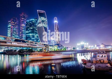 Moscow city skyscrapers beautifully illuminate at night - Stock Image