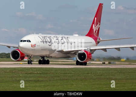 Virgin Atlantic Airways Airbus A330, registration G-VLNM preparing for take off at Manchester Airport, England. - Stock Image