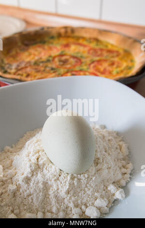 fresh quiche with green eggs, tomatos and spring onions - Stock Image