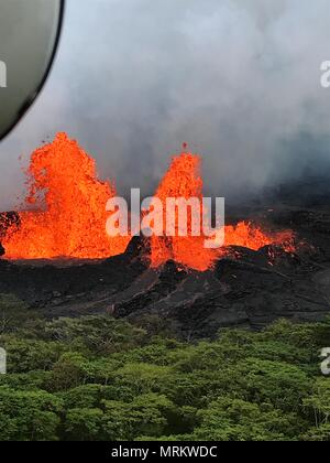 Molten lava spews hundreds of feet into the air at fissure 22 from the eruption of the Kilauea volcano May 21, 2018 in Pahoa, Hawaii. - Stock Image