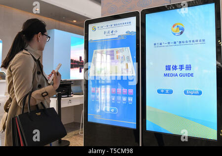 (190423) -- BEIJING, April 23, 2019 (Xinhua) -- A woman views touch screens in the Media Center for the second Belt and Road Forum for International Cooperation in Beijing, capital of China, on April 23, 2019. The media center started trial operation at the China National Convention Center in Beijing Tuesday. More than 4,100 journalists, including 1,600 from overseas, have registered to cover the second Belt and Road Forum for International Cooperation to be held from April 25 to 27 in Beijing. (Xinhua/Li He) - Stock Image