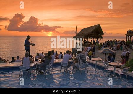 Jamaica Negril Ricks Cafe Open air Pool Bar Viewpoint at Sunset - Stock Image