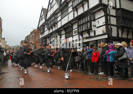 Rochester, Kent, UK. 1st December 2018: A bagpiper bang leads the main parade on Rochester High Street. Hundreds of people attended the Dickensian Festival in Rochester on 1 December 2018. The festival's main parade has participants in Victorian period costume from the Dickensian age. The town and area was the setting of many of Charles Dickens novels and is the setting to two annual festivals in his honor. Photos: David Mbiyu/ Alamy Live News - Stock Image