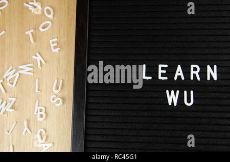 learn language sign on black background - Stock Image