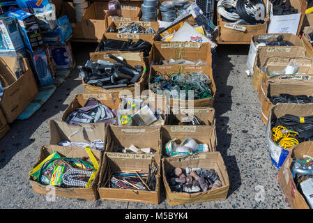 New York, NY 7 July 2014 - Miscellaneous items in cardboard boxes offered for sale on the sidewalk on Canal Street. - Stock Image