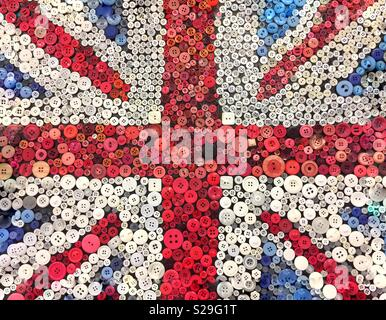 A British Union Jack flag made from buttons or pins in a patriotic background image with copy space - Stock Image